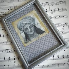 Another little portrait framed with a cool chrome finish