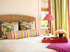 love the beachy window treatment and headboard ~ & the bright colors!!!