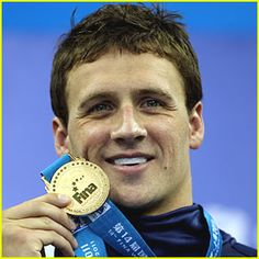 """Wearing diamond-studded grillz in his mouth and lime-green sneakers on the feet that powered him through the water faster than anyone else, Lochte strolled around the deck kissing his medal while Bruce Springsteen's ""Born in the USA"" played over the loudspeaker."" : Loving every part of this sentence and all I can say is I'm proud to be American!"