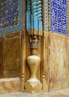 The ribbon like light blue detail that runs around the entrance arch seems to start as though it were to be a column.