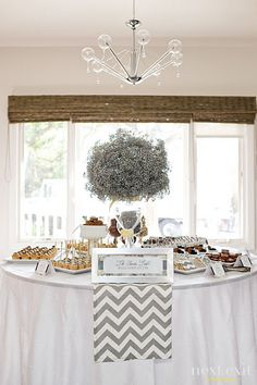 Silver in a chevron pattern...all we need is navy and we'll be good to go!  Wedding chevron/silver decor for cocktail appetizers table.