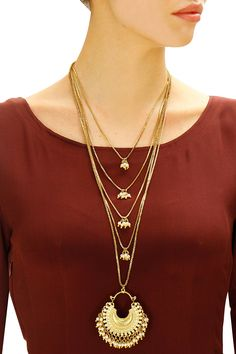 Gold plated crescent pearls multiple strand necklace available only at Pernia's Pop-Up Shop.