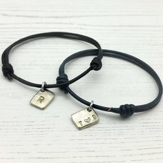 Matching couples bracelets with mini charm, threaded with a choice of leather thong and able to be personalised with up to three characters. These handmade personalised pewter bracelets have a relaxed, genderfree style and use a classic friendship slide knot fastening. With a