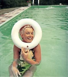 Marilyn. Pool sitting. Photo by Milton Greene, 1956.