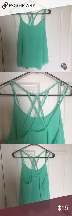 Flowy summer shirt Bright green/blue shirt with a detailed back. Size: large. Perfect for summer. Has only been worn once! Tops Blouses