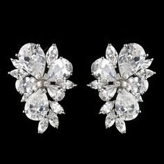 Bold  Cz Cluster Wedding Earrings on Tradesy Weddings (formerly Recycled Bride), the world's largest wedding marketplace.