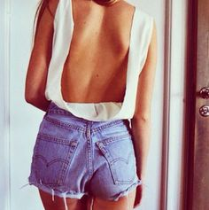 loveee the backless top with the high waist levis cutoffs (;