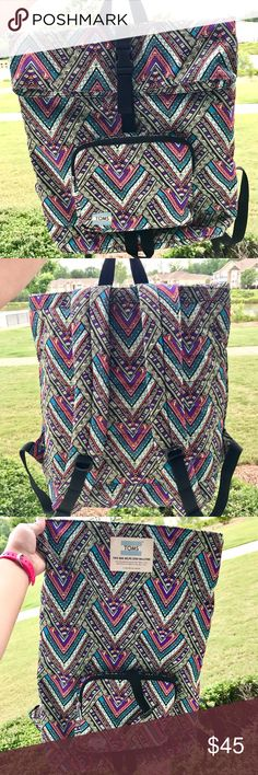TOMS Stand Up Backpack TOMS fight against bullying Backpack! In excellent condition. Zips open at the top and folds over and clips secure. Has a laptop padded pocket with Velcro closure. Super cute and holds a bunch! 15% off 2+ itemsPLUS an added surprise w/ ea. purchase Toms Bags Backpacks