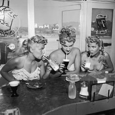 Three blonde women in bathing suits sit at the counter of a. Three blonde women in bathing suits sit at the counter of a beach-front soda fountain, having a snack and drinking from straws. Mode Vintage, Vintage Love, Vintage Beauty, Retro Vintage, Vintage Fashion, Vintage Pins, Pin Up, Vintage Poster, Soda Fountain