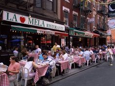 Little Italy, NYC. We ate here and it is fabulous! No menus. They just put jugs of wine on your table and bring platefuls of food...family style. So good!