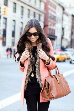 Love this rose colored coat paired with a (hopefully faux) fur vest and all black outfit