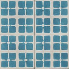 Indian Fleur Reproduction Tile by Jatana Interiors. Beautiful Indian Fleur shapes with tones of smokey blue and soft grey, a spin on the conventional flower.