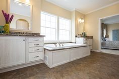 We could spend a LOT of time relaxing in this beautiful master bathroom. 58FRE32663EM • 1958 sq.ft • 3 Beds • 2 Baths #masterbathroom #manufacturedhome #claytonhomes