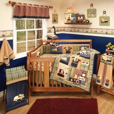 Rich colors of navy, moss green, tan, ivory, and burgundy with detailed appliqué and embroidery of tools, cement truck, front loaders, dump trucks, and wrecking ball trucks: everything your little builder will need!