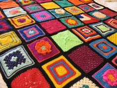 """Multi coloured blanket of individual squares { The patterns for each square come from a book by Jan Eaton,  """"200 Crochet Blocks"""". }"""