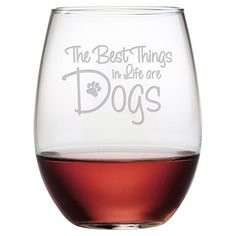 Raise a toast to your favorite furry friend with this charming wine glass, showcasing sand-etched typography and a paw print.