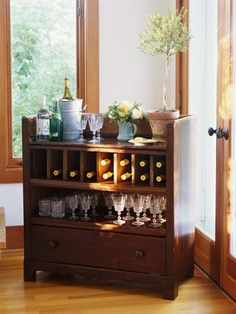 Reconsider beat-up flea market finds like this old dresser. By removing a few drawers and re-staining the piece, it was transformed into the perfect mini-bar.