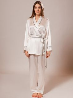 Stunning ladies silk pajamas set features a wrapped top and matching pants. 100% pure mulberry silk fabric offers huge benefits to eczema and dry skin sufferers. Using the finest mulberry silk, this item is soft and breathable making them the ultimate in sleepwear for discerning women.