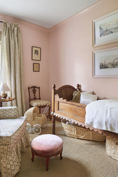 There's a tidy practicality to daughter Eaddy's bedroom. Seabrook relied on classic, collected nursery pieces rather than anything modern to outfit the room: an antique walnut crib, muted pink walls, and a nostalgic but mature fabric—Schumacher's Cabanon Stripe. #homedecor #hometour #southernliving
