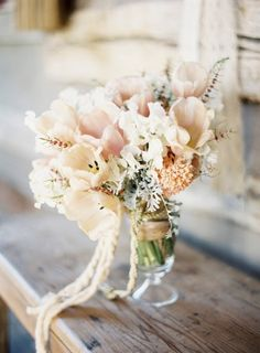 Love the soft neutral flower colors with different textures in this bouquet! Could also be simple center pieces