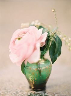 Love peonies.. most especially the blush pink contrasting with the emerald vase/gold detailing.