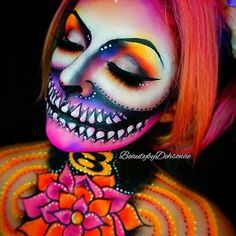 Lotus Skull Products Used: @wolfefaceartfx hydrocolor in black and white, @mehronmakeup paradise aquacolors in yellow, pink and orange, @sugarpill shadows in poison plum, flamepoint, dollipop, buttercupcake, love+ and diamond eyes, @meltcosmetics dark matter, @alexfaction lashes on bottom and Halloween style lashes on top, contacts in solar eclipse by @camoeyes.com_ , hair by Toni @hairitagesaloncarlsbad.