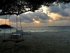 An idyllic sunset at Club Faru, a resort island near Male, capital of the Maldives.