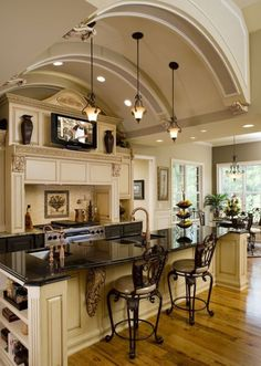 Delicious!!!!!! That is what this kitchen is:) Hardwood floor is gorgeous, and I love the TV where it is.