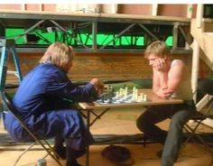 Josh and Woody playing chess on the set of 'Catching Fire'.