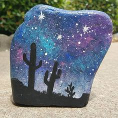"""""""Desert Night"""" (4"""" x 4"""" x 1""""), acrylic on stone. The starry sky is full of silver glitter though it was hard to capture the sparkle in my photos. #paintedrock #paintedstone #stoneart #acrylicpainting #saguaro #cactussillouette #galaxypainting #nightsky #starrynight #rockart #rockpainting #stonepainting #desertnight"""