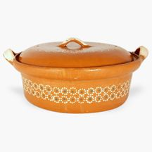 This traditional clay cazuela, Spanish for casserole, comes from the Mexican state of Michoacán and is made by a large extended family with a long history of making cookware and pottery. All their pieces are completely handmade, lead free and food safe for cooking.