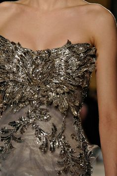 The dress looks like its covered with angel feathers.