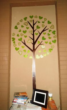 """My new """"guestbook"""" wall tattoo in my dining room. Every time we have a dinner party the guests must sign a leaf."""