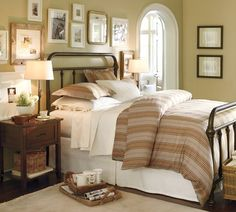 i want to copy the pictures above bed. also love the lamps.  bed frame too but want one not as bulky.  thats all :)