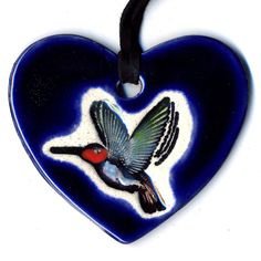 Hummingbird Heart Ceramic Necklace in Midnight Blue by surly, $20.00