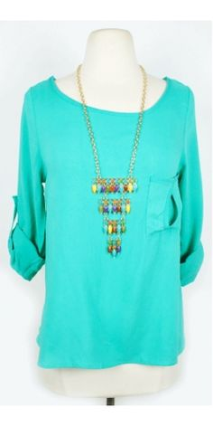 adorable teal pocket top, check out the back too! $34.50