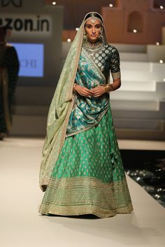 In shades of blue & green, this Sabyasachi lehenga is for the mughal-inspired bride.