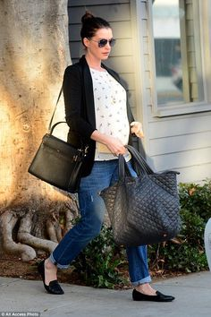 Anne Hathaway wearing Valentino My Rockstud Satchel and Mz Wallace Metro Tote