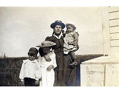 Mi'kmaq woman and three children, ca. 1908. We need NAMES of Native women - very hard to find - did anyone record their achievements?