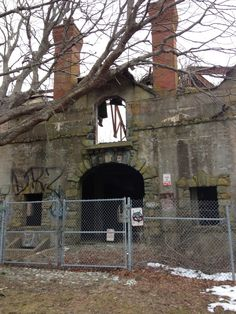 """The abandoned (neglected) and deteriorated carriage barn – referred to as """"The Bells"""" by locals – found at Brenton Point State Park in Newport, Rhode Island."""