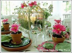 """This theme is all about a """"garden party"""". It is so bright and cheerful! She used a miniature glass greenhouse, decorated with flowers for her centerpiece.    Terra cotta clay pottery is inexpensive and makes a fantastic table setting idea for summer parties. Using the terra cotta clay saucer for a charger plate is brilliant!"""