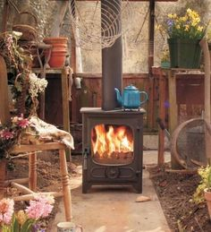 Charnwood Country 4 Multi Fuel / Wood Burning Defra Approved Stove : Chimeneas y accesorios de Direct Stoves