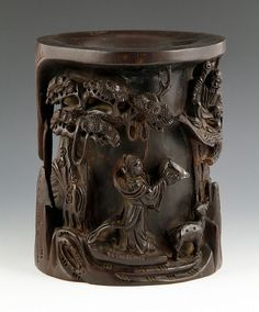 "Brush pot, China, 18th century, zitan wood, with high relief carving of mountain scene with figures and animals, 9"" h x 7 1/4"" dia. 8/12000"
