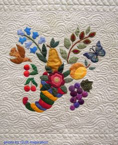 """close up, cornucopia block, in: Album Quilt by Louise Robertson, quilted by Karolyn """"Nubin""""Jensen.  Photo by Quilt Inspiration."""
