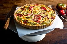 NYT Cooking: The tomato tarts and quiches I've been eating in Provence are delightful. Spreading mustard on the crust before you top it with tomatoes is a new idea that makes perfect sense to me, as mustard is such a perfect condiment for tomatoes.