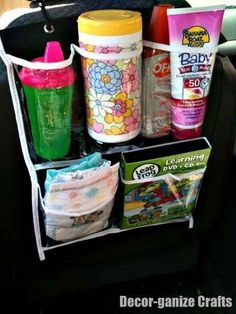 Make road trips more tolerable by filling a hanging shoe organizer with things to entertain your kids.