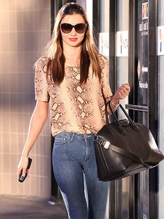 "Miranda Kerr with a black Givenchy ""Antigona"" satchel"