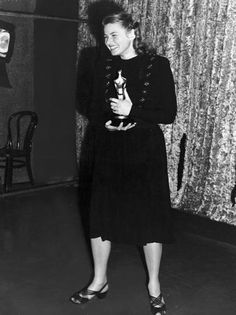 """6/7/14  12:10p  The Academy Awards 1957: Ingrid Bergman Best Actress  Oscar  for """"Anastasia"""" 1956  Presenter: Ernest Borgnine  Accepting for Ingrid Bergman Cary Grant  Photo from  1945  Ceremony"""