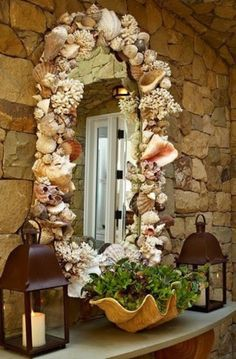 decorating with sea shells - the mirror is over the top for me, but I love the giant shell planter