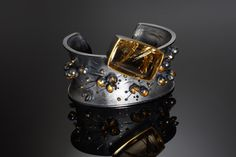 Liang-Chung Yen: Flourishing Cuff #1, sterling silver, 18k & 22k yellow gold, rutlie quartz.